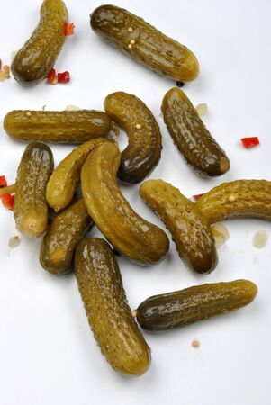 gherkins: some sour gherkins and a white background