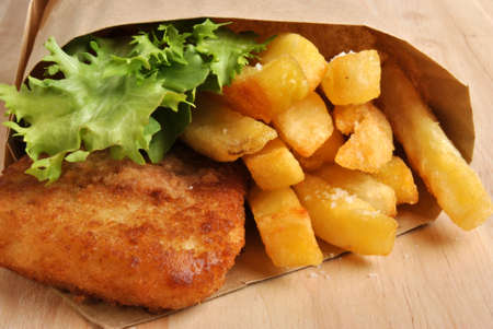 fish and chips with some organic salad photo
