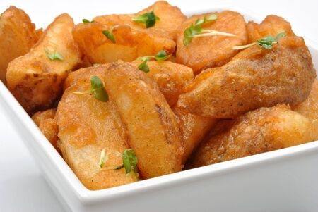 wedges: some fried potato wedges in a bowl