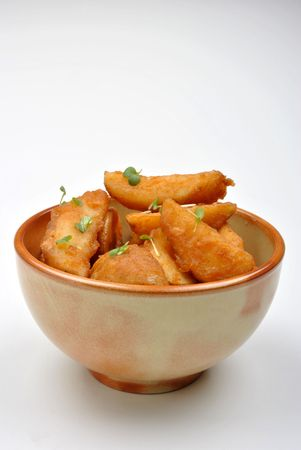 some fried potato wedges in a bowl