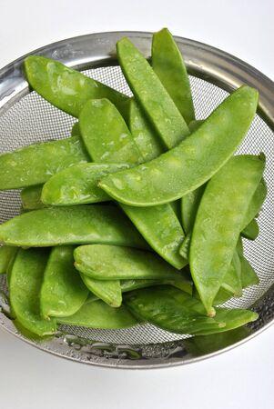 fresh organic mangetout, also known as sugar snap pea photo