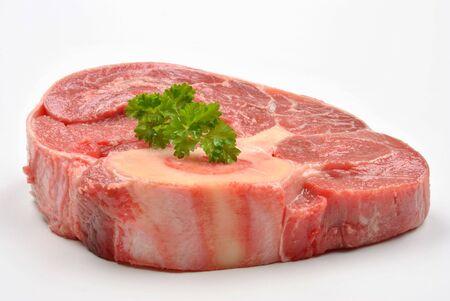 shin: fresh organic beef shin steak and white background