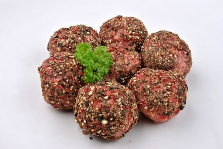 peppered: peppered minced meat balls on a plate Stock Photo