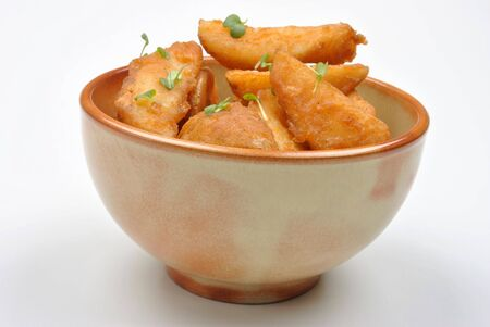 potato wedges: some fried potato wedges in a bowl