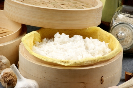 organic rice steamed in a bamboo steamer Stock Photo