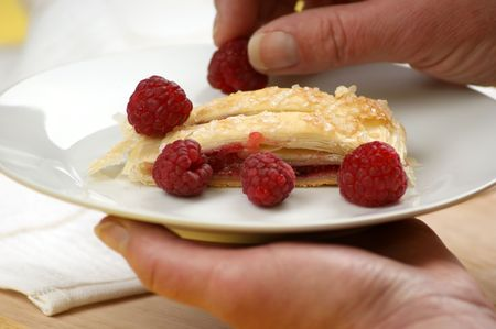 home made fruit strudel with sweet raspberries photo