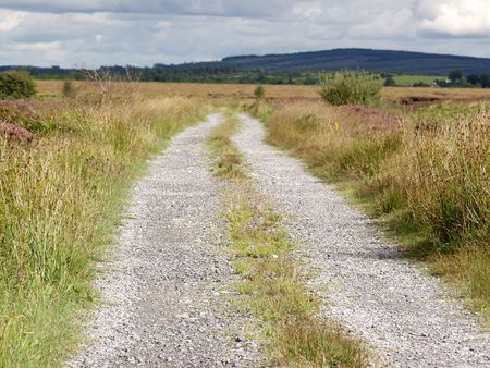 road with gravel in the country to nowhere photo