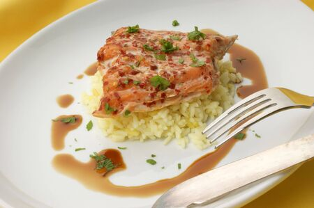 peppered: peppered wild salmon steak with organic rice Stock Photo