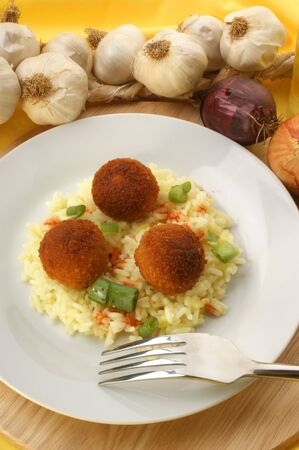 chicken meat: chicken meat balls with rice on a plate
