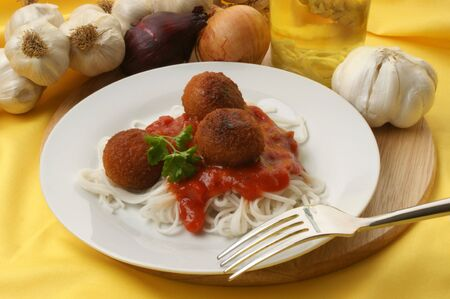 meatballs with organic spaghetti on a plate photo