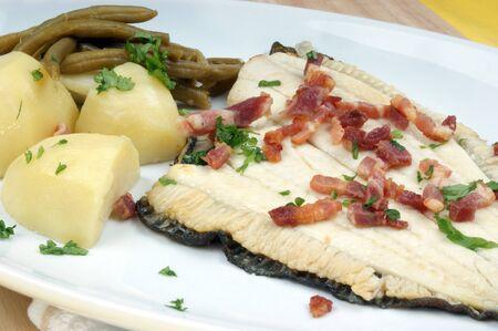 plaice: plaice with some potato and organic beans Stock Photo