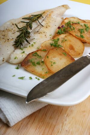 plaice: plaice with some potato and organic beans Stock Photo