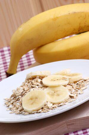 breakfast with organic oatmeal and fresh banana photo