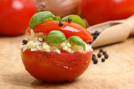 some grilled organic tomato with rice stuffing Stock Photo