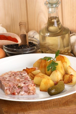 gelatine: roasted potato with cured meat in gelatine Stock Photo