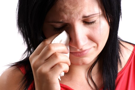 a young woman is sad and crying