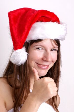 a young woman carries a christmas hat Stock Photo - 7671134