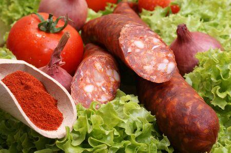 home made salami on some fresh organic salad photo