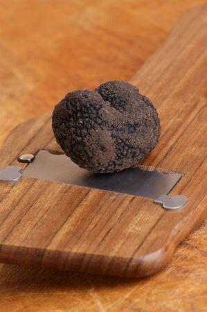 slicer: one organic summer truffle and a truffle slicer