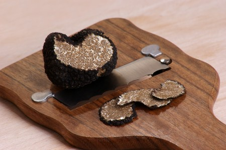 organic summer truffle on a truffle slicer Stock Photo