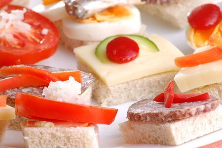 nibbles: some party nibbles on a white plate Stock Photo
