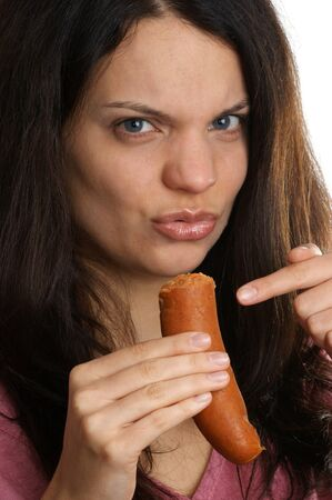 a young woman does not like this sausage photo