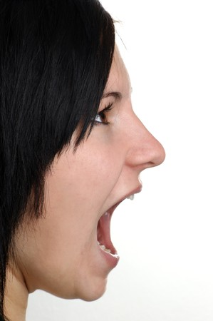 a young woman is shouting with her open mouth photo