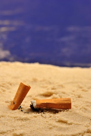 ends: some cigarette ends on a sandy beach
