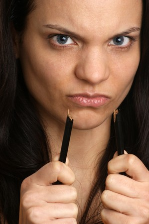 young woman with a broken black pencil in her hand photo