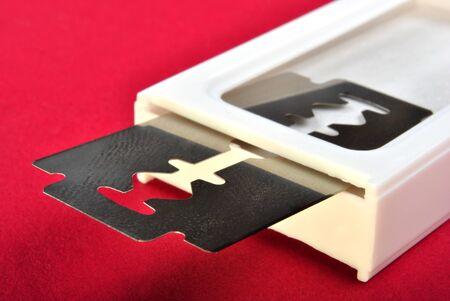 razor blade: one razor blade and a white pvc box Stock Photo