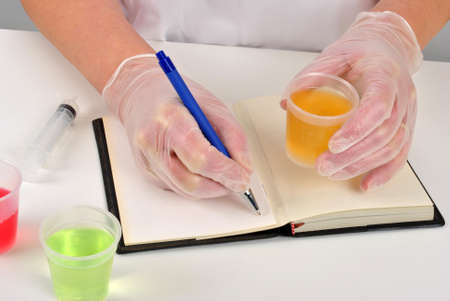 some yellow liquid and make some notes photo