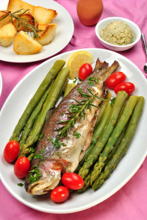 grilled rainbow trout with organic green asparagus photo