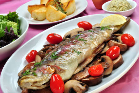 grilled rainbow trout with some organic mushroom photo