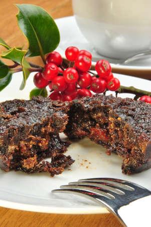 christmas pudding: home made christmas pudding on a plate Stock Photo