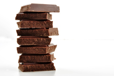 some stacked chocolate and a white background Stock Photo
