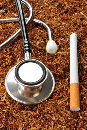 some unhealthy tobacco cigarette and a stethoscope photo