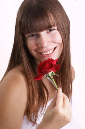 a young woman holds a red rose photo