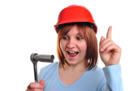 socket wrench: young woman with helmet holds a socket wrench Stock Photo