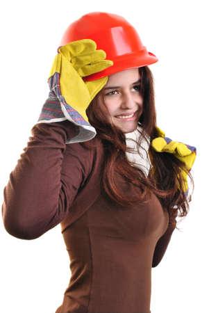safety helmet: joven tiene un casco de seguridad rojo