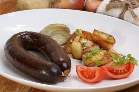 home made black pudding with grilled potato photo