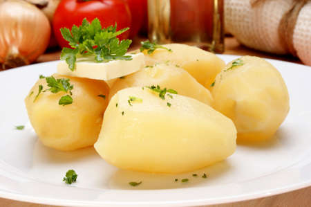 Parsley and butter on boiled potatoes Stock Photo - 9176671