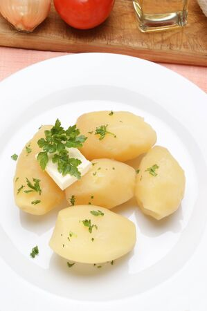 Parsley and butter on boiled potatoes Stock Photo - 9176667