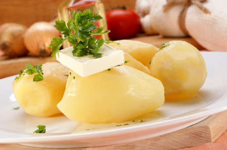 Parsley and butter on boiled potatoes Stock Photo - 9182048