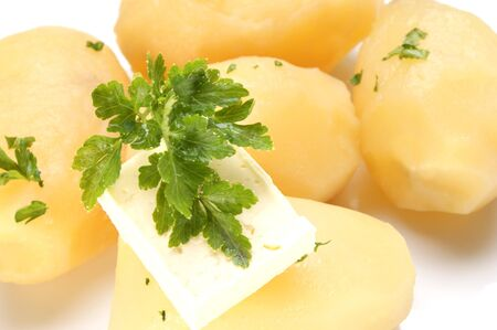 Parsley and butter on boiled potatoes Stock Photo - 9390900