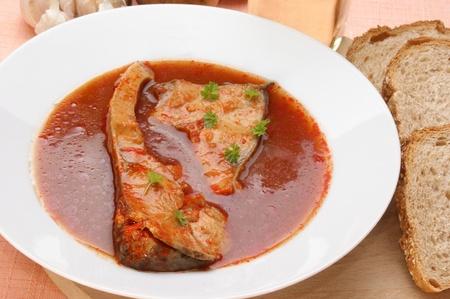 tasty carp fish soup in a porcelain dish