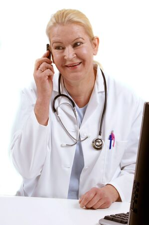 medical assistant with a cordless phone and white background Stock Photo - 9538348