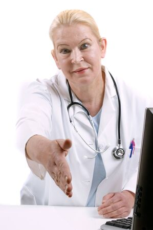 medical assistant: medical assistant gives her hand to say hello Stock Photo