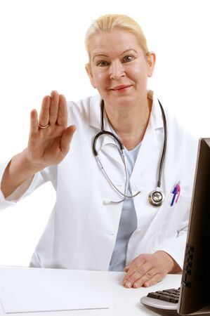 medical assistant raises her hand to say good bye photo