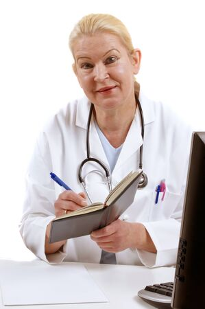 medical assistant: medical assistant takes notes in a book