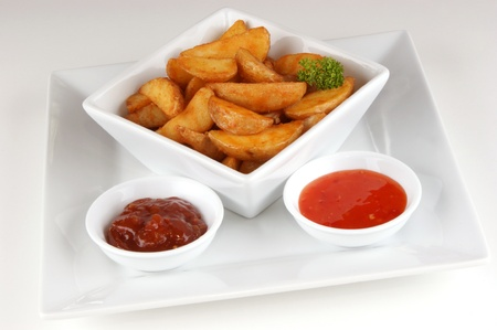 grilled potato wedges with home made spicy sauce Stock Photo - 9613677